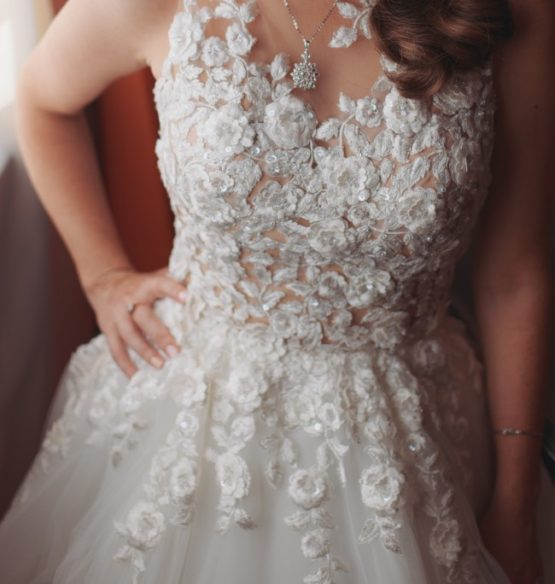 Pretty flower lace bridal gown for a fuller figured plus size bride