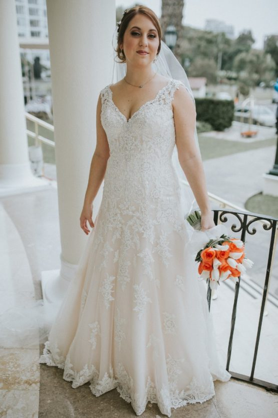 Sleeveless v-neck plus size bridal gown from Darius Bridal