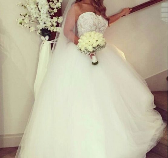 Strapless plus size ball gown wedding dress from Darius Bridal