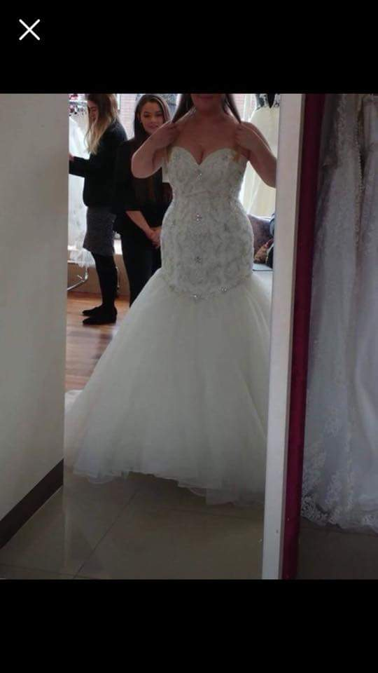 plus size fit-and-flare wedding gown from Darius Bridal ...