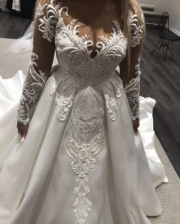 plus size long sheer sleeve wedding dress with ball gown over skirt