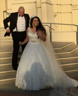 sleeveless plus size bridal dress with beaded belt from Darius Customs