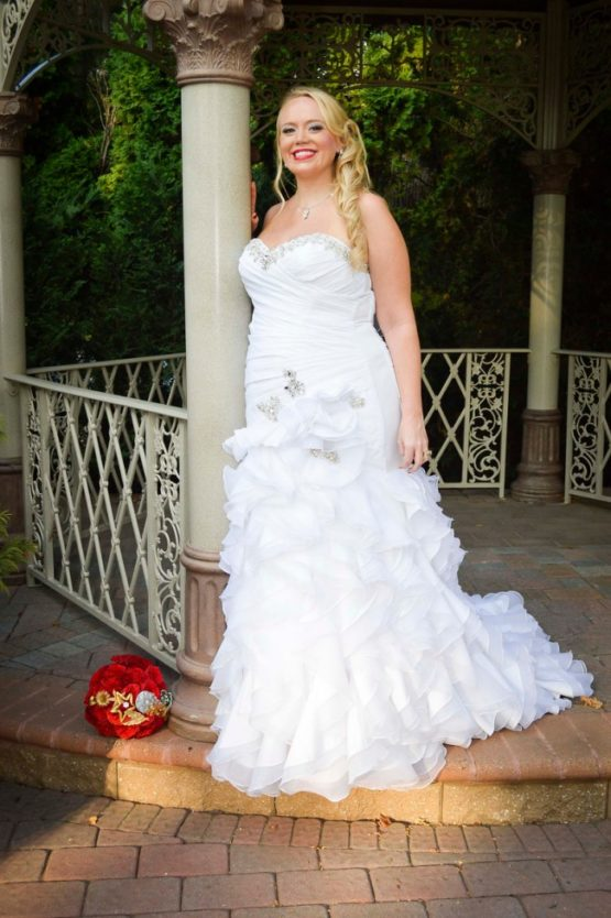 strapless plus size wedding gown with ruffled skirt